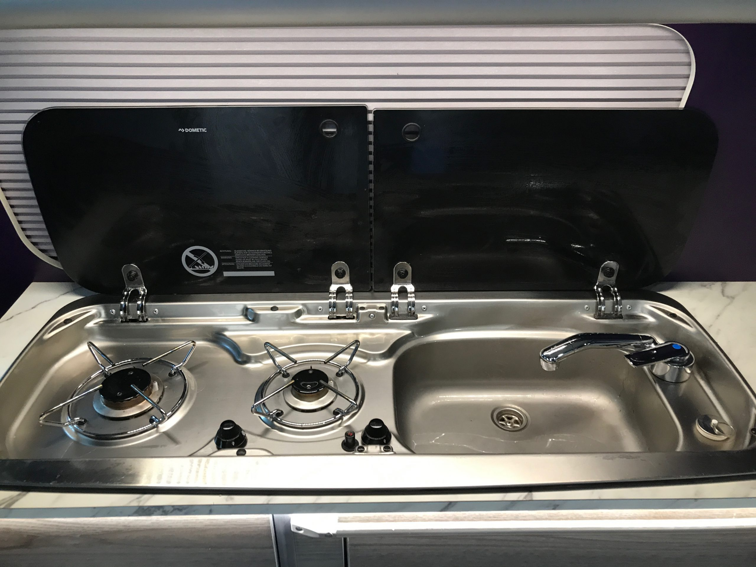Double gas hob and sink with cold water tap